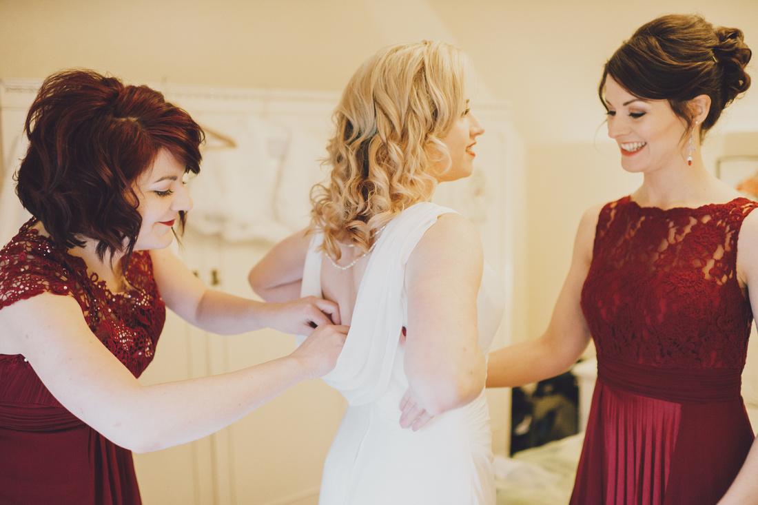 putting the wedding dress on bridal prep Menteith Cottage Aberfoyle