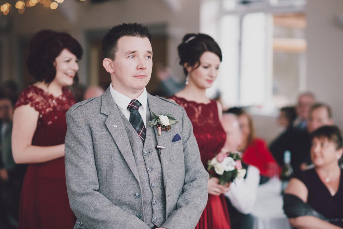 Groom waiting bridesmaids Kinlochard Village Hall Wedding Scotland