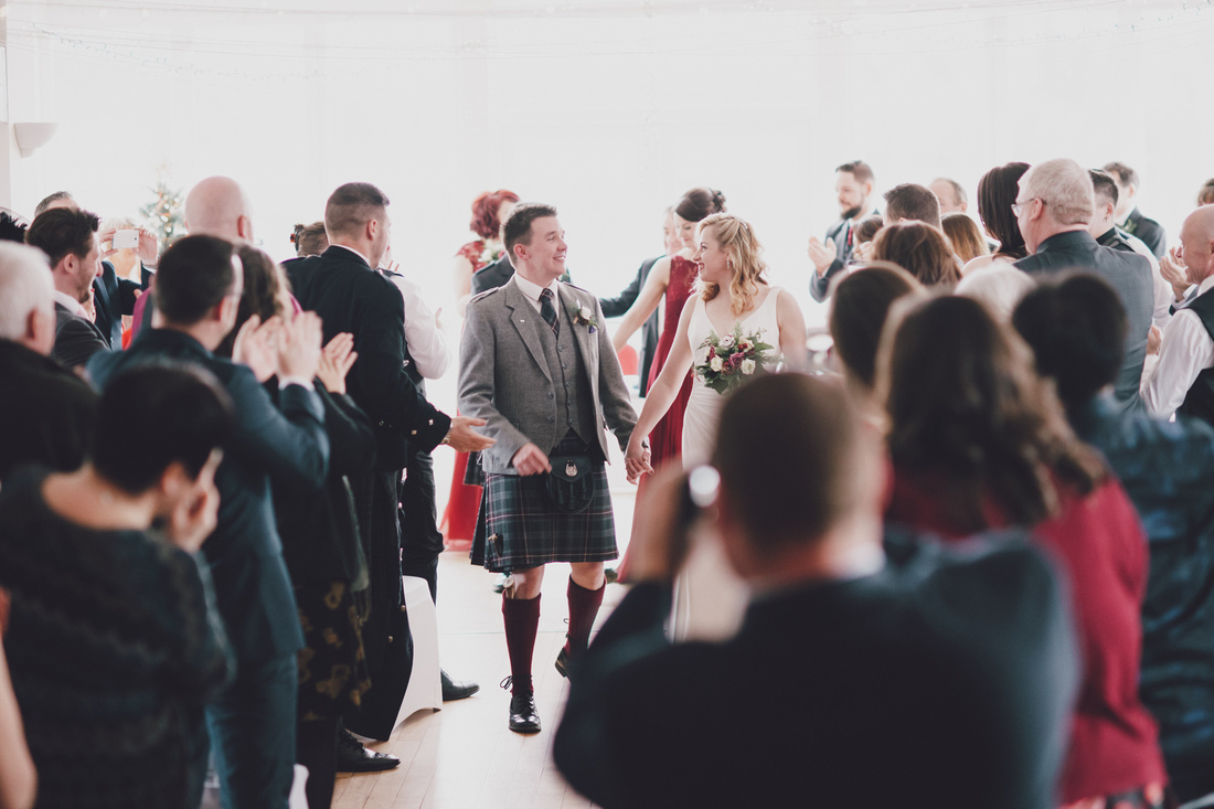Bride and Groom married walking down aisle  Kinlochard Village Hall Wedding Scotland