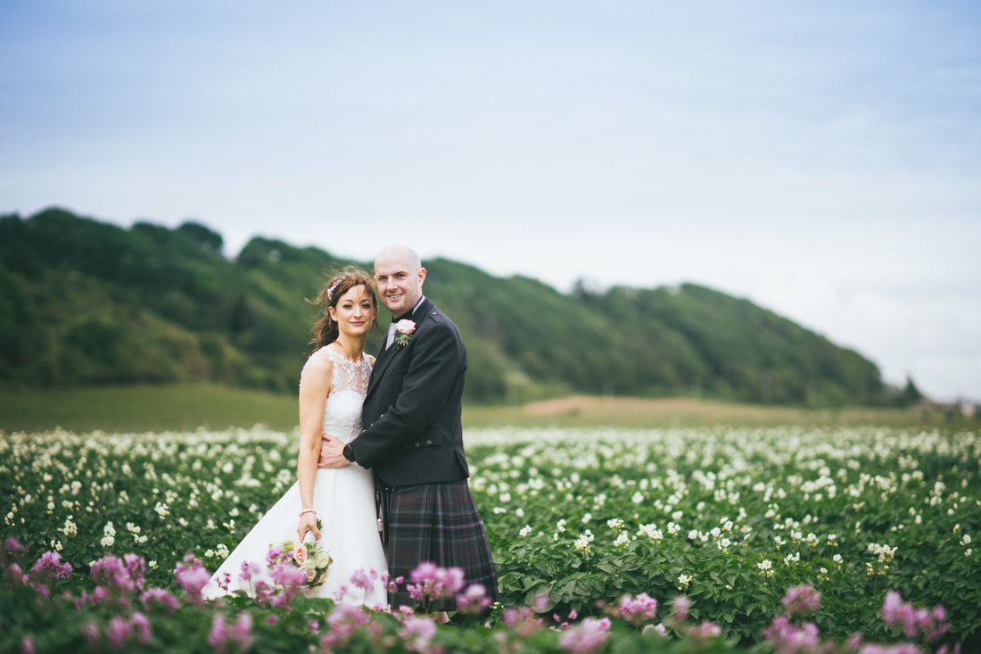 Bride and Groom flowers potato field Wedding Photos Waterside hotel Ayrshire