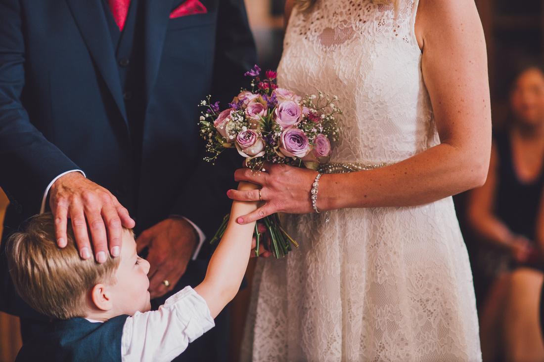 son bringing wedding flowers