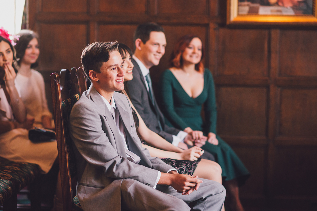 Guests smiling during ceremony