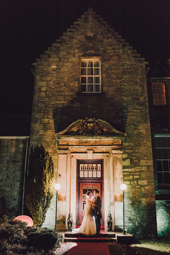 Bride and Groom outside Kilconquhar Castle night time backlit flash