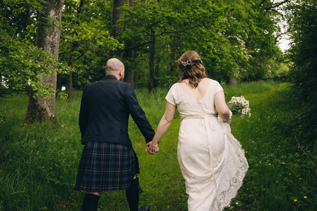 Couple time wedding photographs in the woods