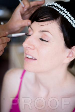 Bride putting make up on