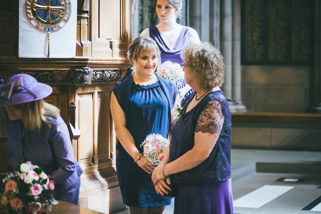 Bridesmaid smiling at Glasgow University Chapel