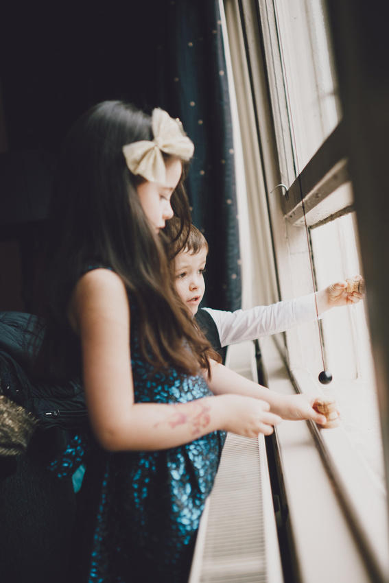 Kids looking out window - wedding