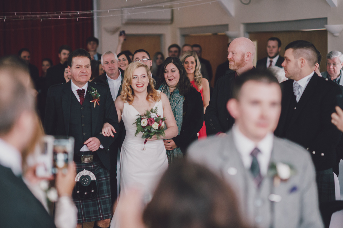 Brides arrival aisle Kinlochard Village Hall Wedding Scotland