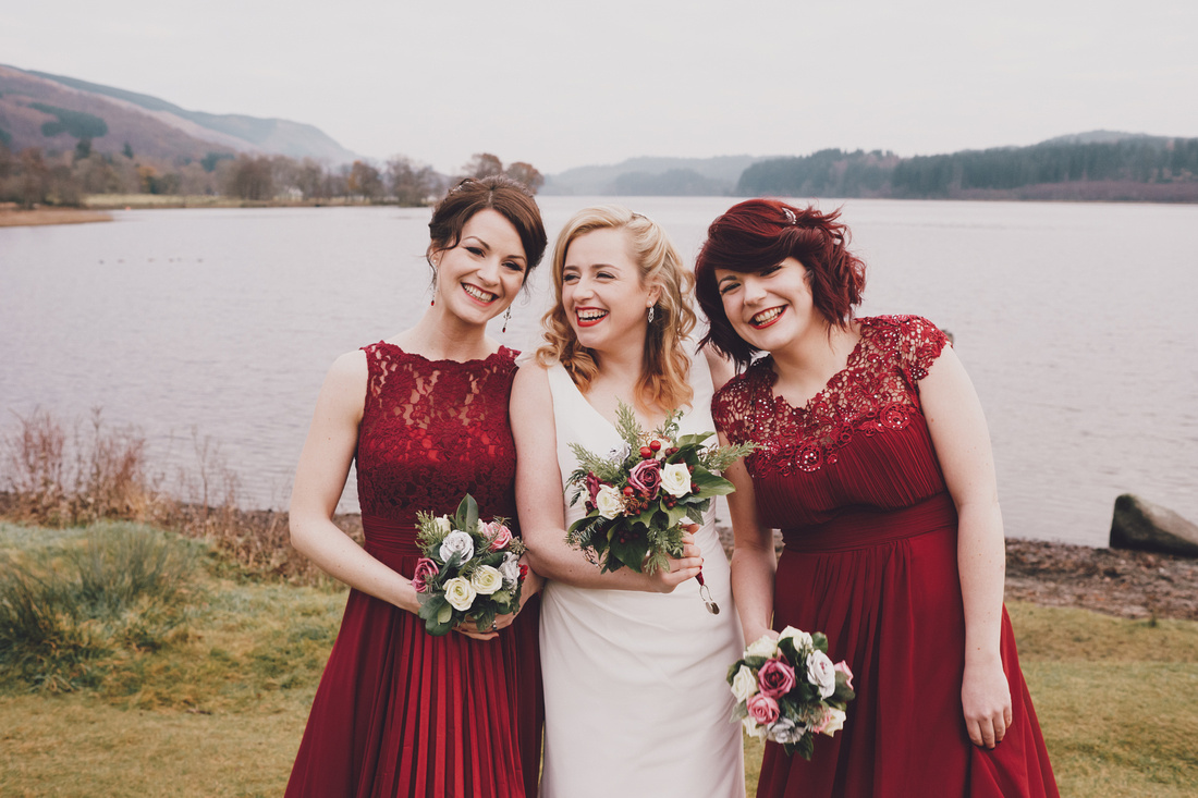 Bridesmaids and bride smiling Kinlochard Village Hall Wedding Scotland
