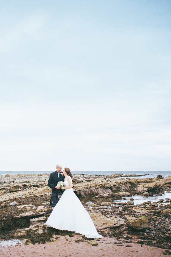 Bride and Groom on the rocks Beach  Wedding Photos Waterside hotel Ayrshire