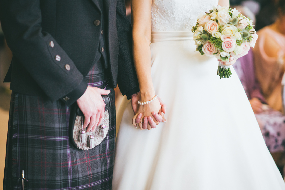 bride and groom holding hands Waterside hotel Ayrshire