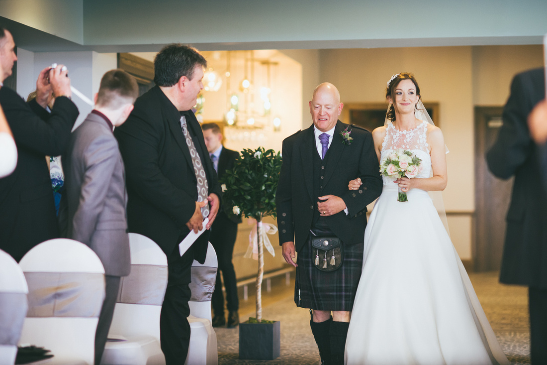 Bride and Father walking down aisle Waterside hotel Ayrshire