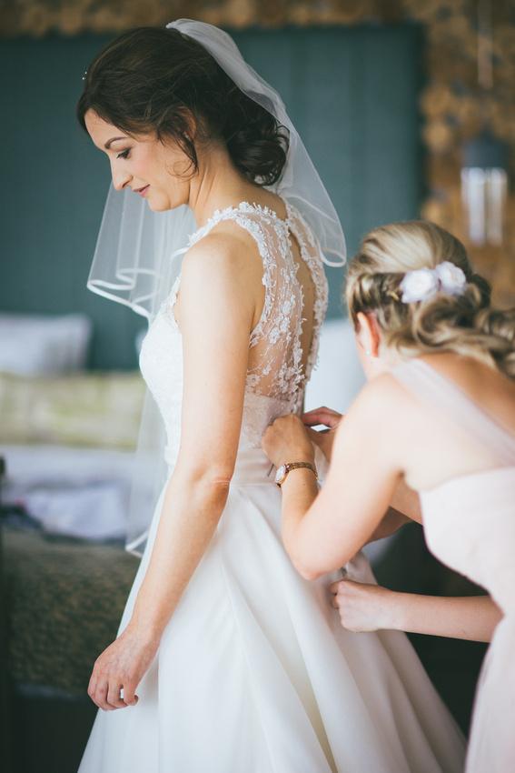 Bridesmaid doing up dress Waterside hotel Ayrshire