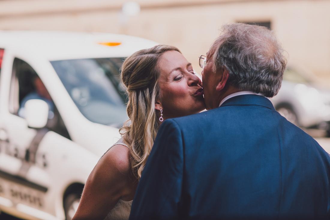 Bride kissing father Montrose Street Glasgow