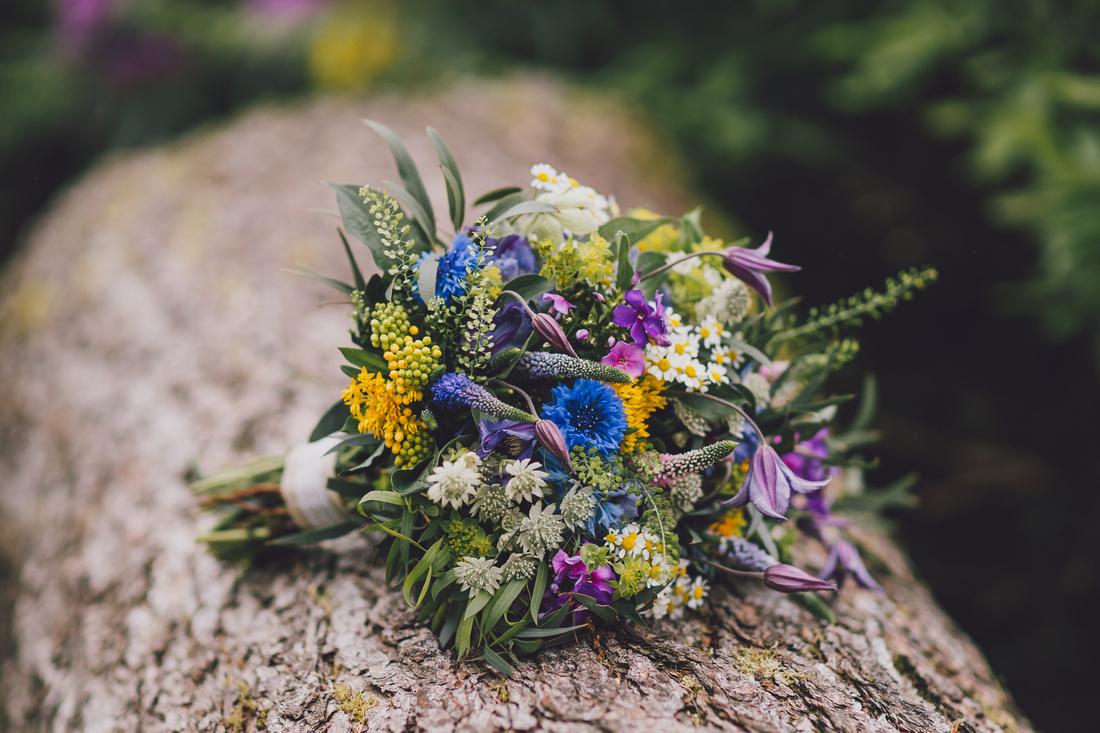 Brides flowers on a log