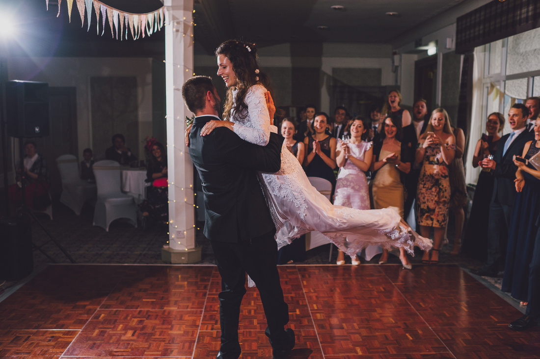 First dance Groom lifting Bride