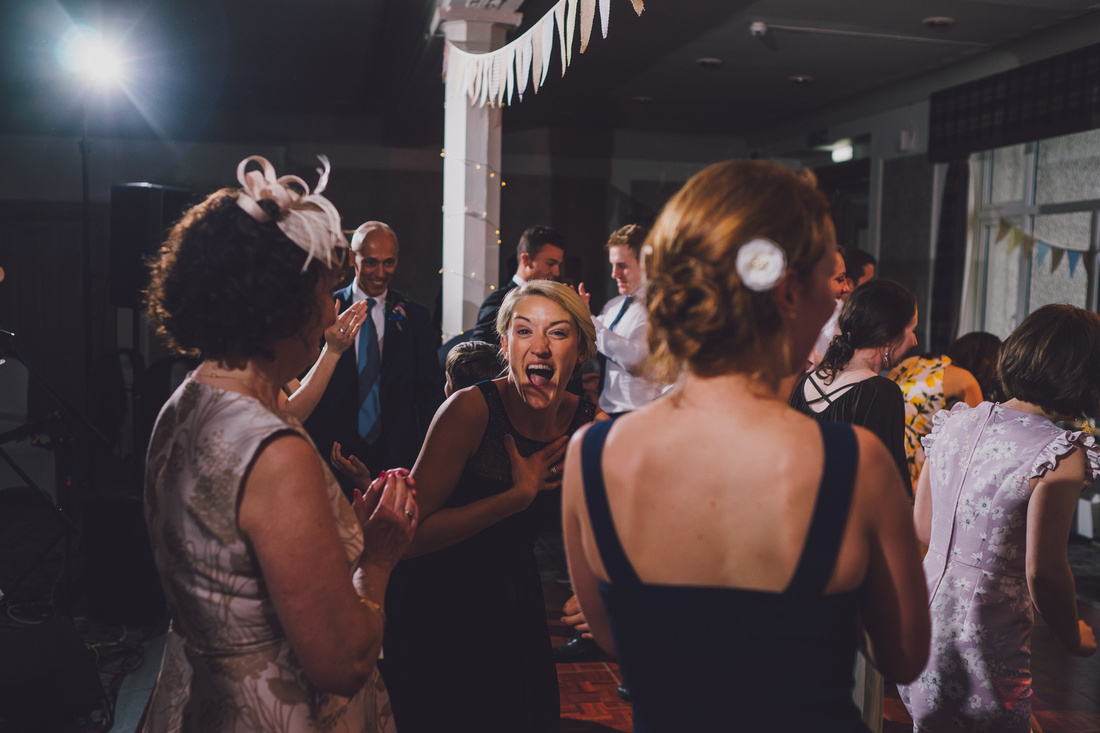 Bridesmaid dancing laughter