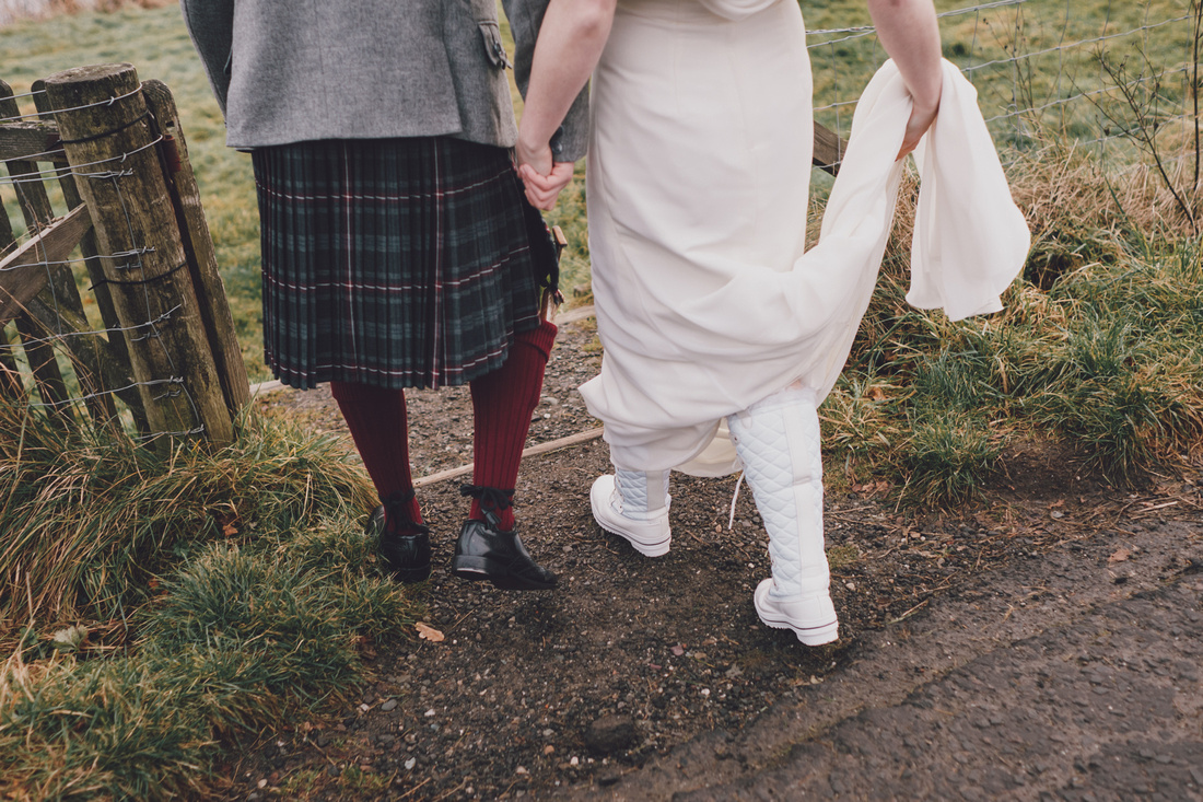 Bride and Groom walking feet white wedding boots Kinlochard Village Hall Wedding Scotland