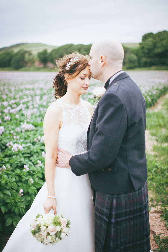 Bride and Groom flowers potato field  kiss Wedding Photos Waterside hotel Ayrshire
