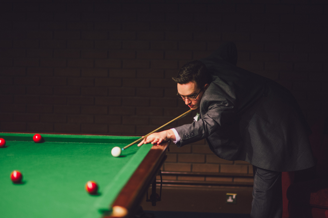 Groom playing snooker