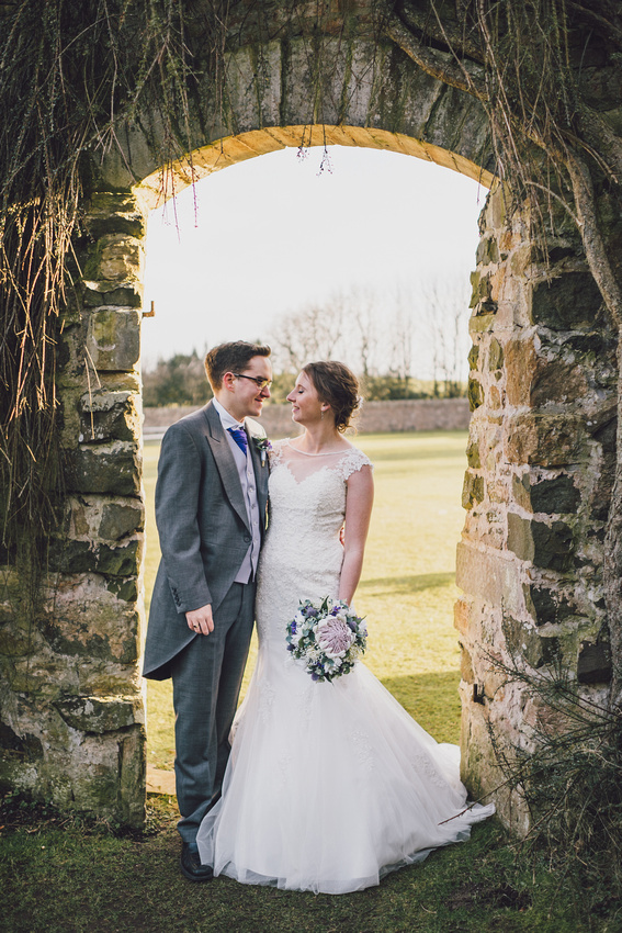 Walled garden arch wedding couple