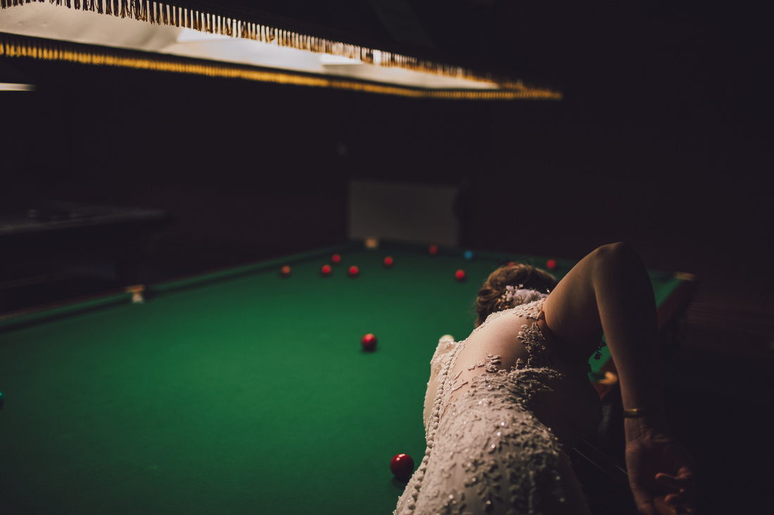 Bride playing snooker