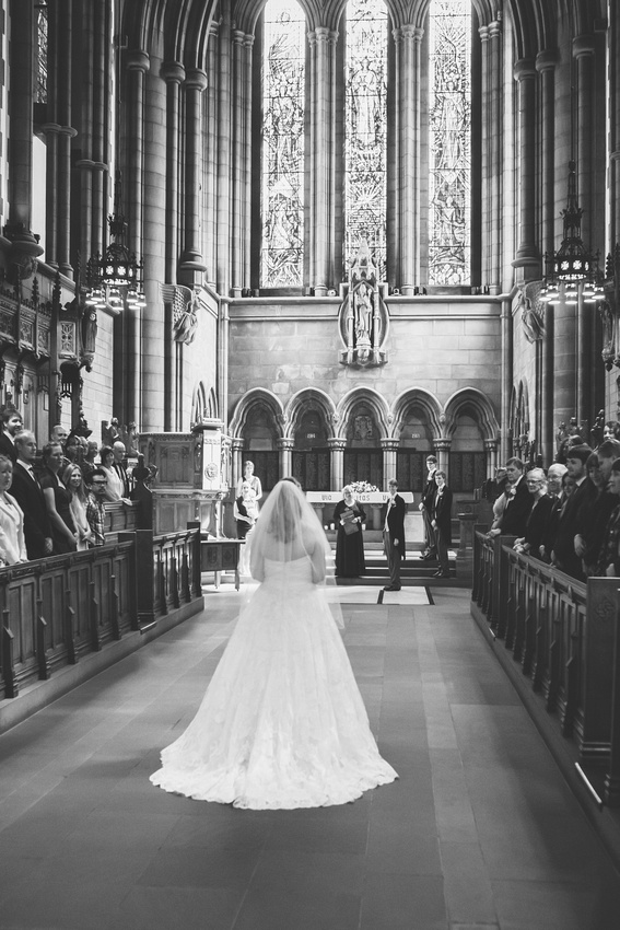 Bride walking down the aisle at Glasgow University Chapel