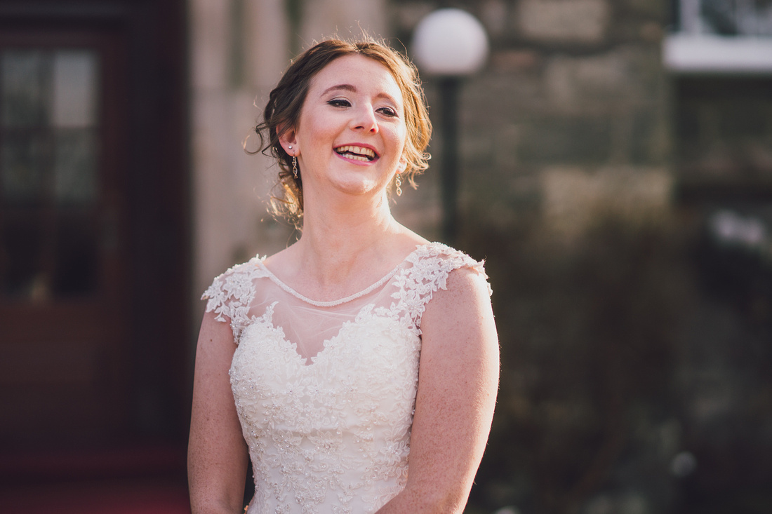 Bride laughing at guests arriving late