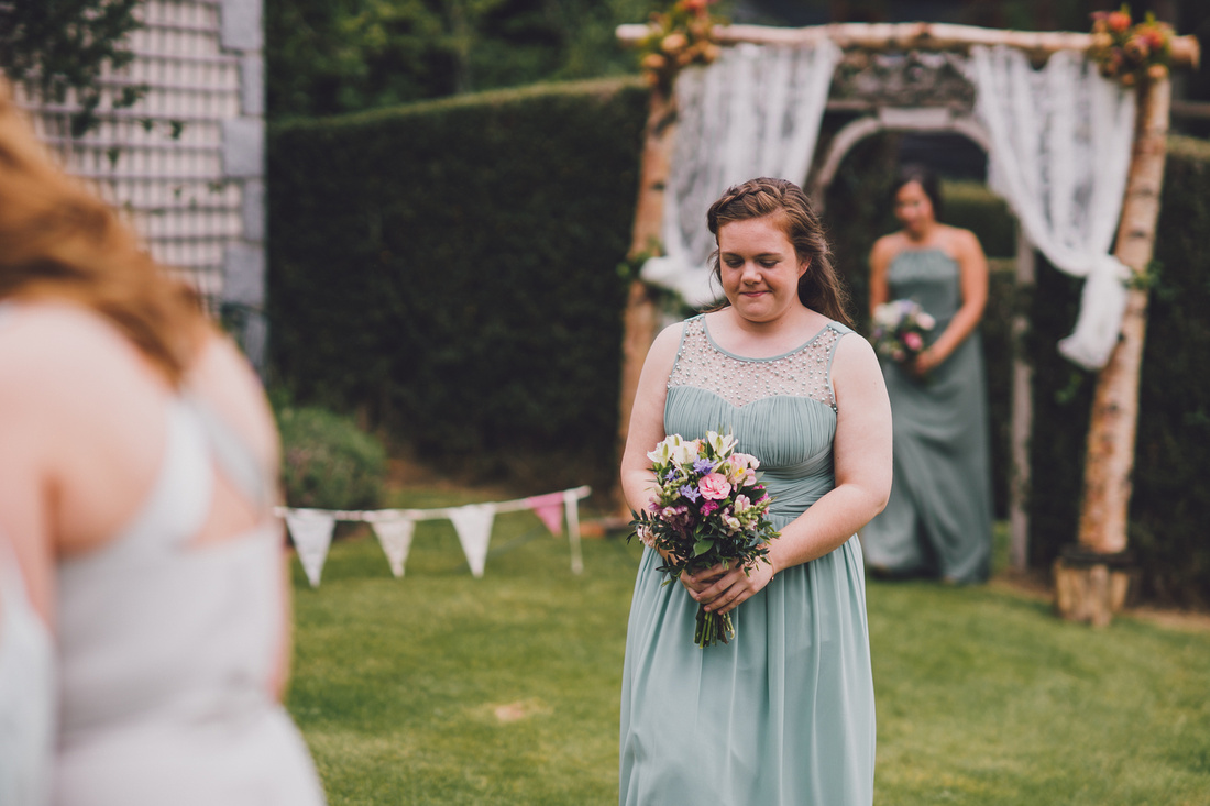 Bridesmaid walking down the aisle at Mar Lodge Cottages